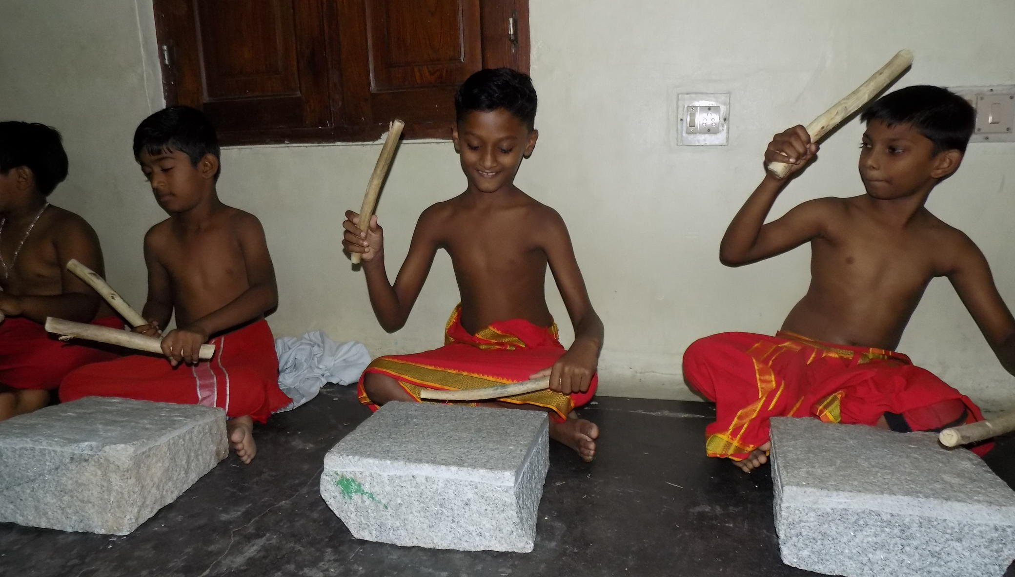 Musical instruments for 17 slum children in India