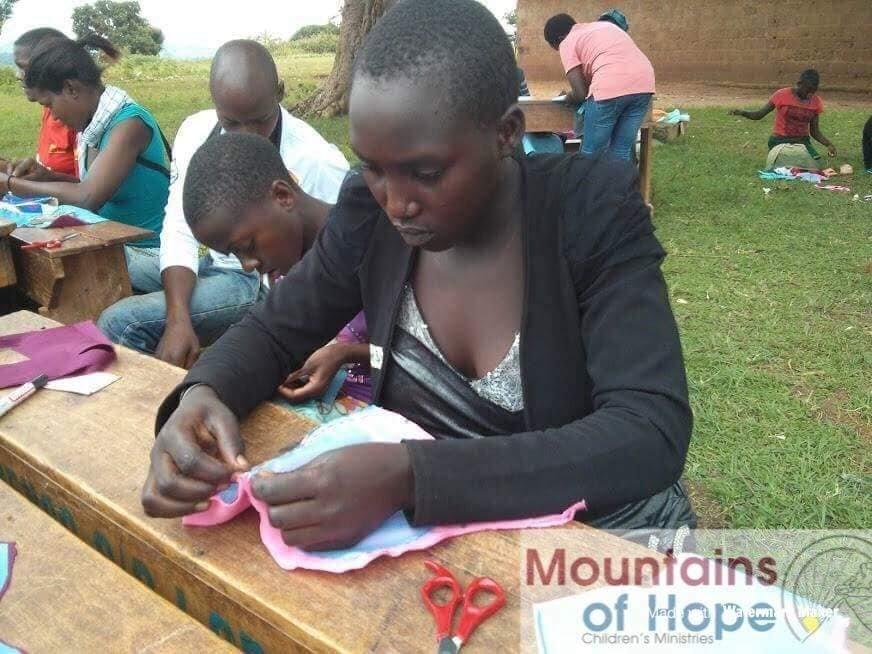 Train 700 girls to sew sanitary pads in Uganda
